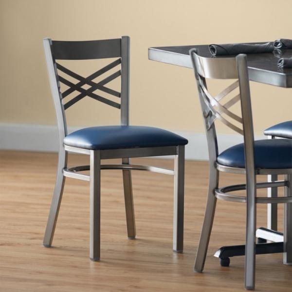 6018 ambientada Silla de Acero 6018 Fabricada en Acero Calibre 18 con asiento acojinado y tapizado. Esmaltada electrostáticamente. Colores de estructura y tapiz son a elección del Cliente.
